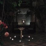 nightime candles around fountain in courtyard