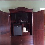 Tv and fridge in armoire