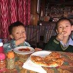 Childrens having Pizza