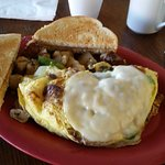 Ham and cheese omelet with red potatoes and toast
