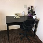 Upscale desk in room for business needs and more
