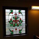 A window near the stairway inside the Hostel