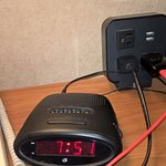 handy plug in for phone and tablet by bed