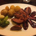 Roasted duck breast with a black cherry and fig purée,golden beets,broccoli,cauliflower, mini ro