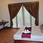 Guest Room of New Mahout Hotel with Garden River View
