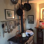 Just inside the kitchen door, this 19th c. woodstove is a lovely feature.