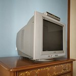 Very old technology TV set in my room 318, not comfortable to watch programmes.