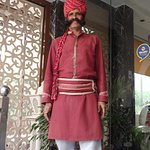The traditional doorman who meets and greets people