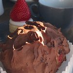 Chocolate hedgehog hiding the strawberry cheesecake.