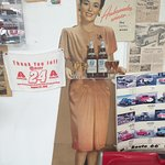 Cardboard cutout of lady serving wine