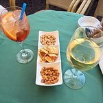Aperol spritz, white wine, and complimentary snacks