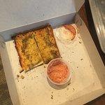 Garlic bread with spicy sauce, sriracha mayo I think? So good!!!!!