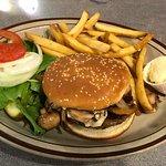 Mushroom burger with fries.