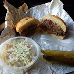 Smoked brisket, coleslaw, kosher pickles.