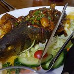 Stuffed Fish, Whole Fish stuffed with prawns, pieces of cod, red onion and spices.