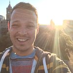Selfie from the top/sunset/old city building and grand America in back