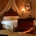 Lillian's Room has a King Size bed, gas fireplace and Jacuzzi tub for two in the private bath..