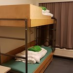 Room with 6 beds. I liked green linings :)