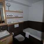 Jacuzzi tub and separate rain shower in the suites