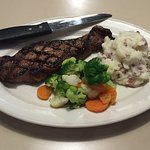 Strip steak, cooked to order.