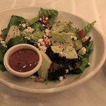 Insalata Primavera (side salad) spring mix, romaine, walnuts, feta, cherry tomatoes, sliced appl
