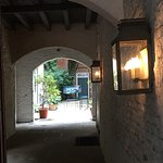 One of the many arched passages to hidden courtyards to be found in the Quarter