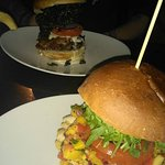 My chicken burger with mango salsa and my partners beef burger with bacon and kale crisps!