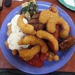 My fish, tartar sauce, fried shrimp, sirloin steak, and sausages