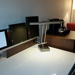 Desk is large workspace with spot lighting and coords for different gadgets