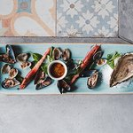 Selection of raw shellfish including oysters, mussels, clams and fish specialities