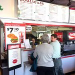 Hooligan's isn't fancy. You order at the window from the very cute young lady and then grab a ta