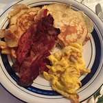 Pancakes, apples, bacon, and scrambled eggs.