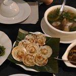 Seaweed salad, baked scallops, fish sinigang, sarad adobo.