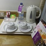 tray with tea kettle, cups and glasses