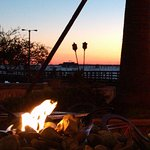 Open pit fireplace with view toward the ocean sunset