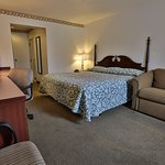 Our King rooms provide a spacious work area, fold out couch, flat screen television, and mini-fr