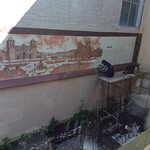 A mural of Cuzco's main square being painted in the hotel courtyard.