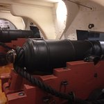 "Full scale model of guns of ""Old Ironsides"" inside museum"
