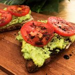 Sourdough toast with smashed avocado, Malden sea salt, fresh tomatoes and balsamic vinegar