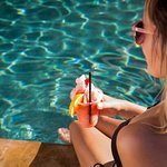 Get your favorite drink while you are at the pool bar.