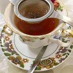Loose leaf tea served with strainer