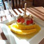 Flambe banana with ice cream & whipped cream