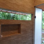 Massive shower with a door to the balcony and an opening facing the jungle. A shower with a view