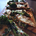 Flatbreads with sausage and broccoli rabe.