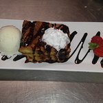 Homemade Raisin Bread Pudding with Chocolate Rum Sauce and Vanilla Bean Ice Cream