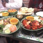 Excellent non veg food Malabar salmon and garlic shrimp..  Kashmiri paneer and Tandoor veg medle