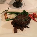 Grilled Angus Beef Tenderloin on a tawny port sauce with wild mushroom medley