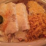 Three chicken enchiladas with refried beans and rice
