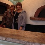 The girls checking out the wood ovens where pizzas are born