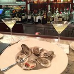 Oysters @ the bar, with jalapeño cucumber martinis!